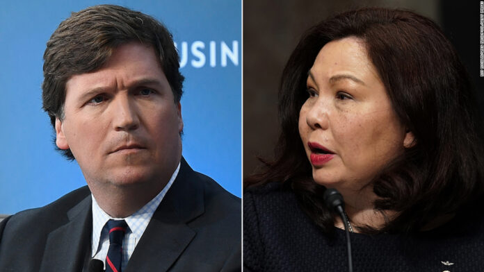 Sen. Tammy Duckworth, who lost her legs serving in Iraq, hits back after Tucker Carlson suggests she hates America