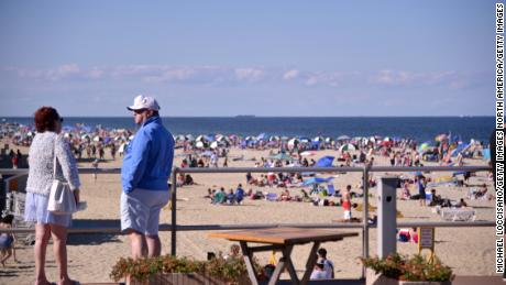 Beaches and bars are being shut down to discourage crowds during the Fourth of July weekend