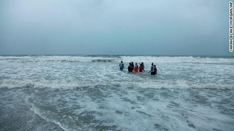 Kerra Houser and her family swim in the North Myrtle Beach, South Carolina surf on Monday, August 3, 2020.