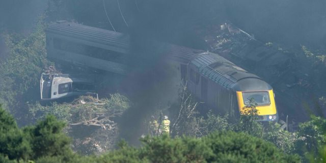 Emergency services personnel are seen at the scene of a train crash near Stonehaven in northeast Scotland on August 12, 2020. (Photo by Michal Wachucik / AFP via Getty Images)
