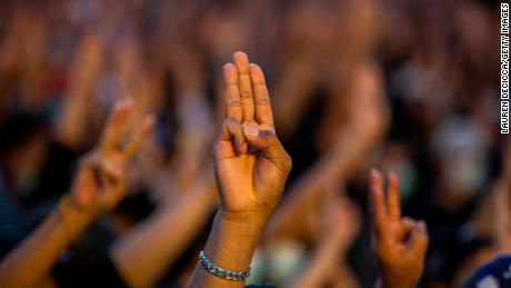 Protesters give a three finger salute at a rally at Democracy Monument on August 16, 2020 in Bangkok.