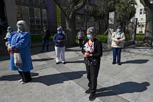 Health workers in Buenos Aires pay homage to a colleague who died from the virus.