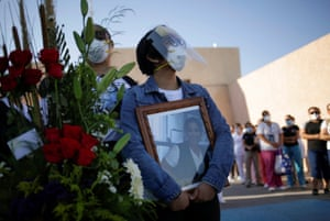 Elizabeth Tovar holds a photograph of her mother Clara Tovar, during a tribute to the former nurse who died of coronavirus in Ciudad Juarez, Mexico.