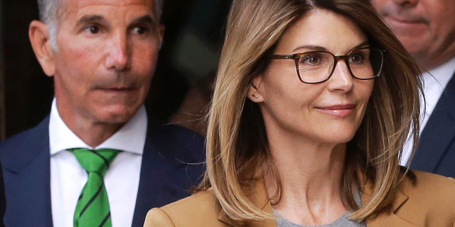 In this April 3, 2019, file photo, actress Lori Loughlin, front, and husband, clothing designer Mossimo Giannulli, left, leave federal court in Boston after facing charges in a nationwide college admissions bribery scandal.