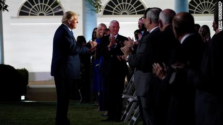 President Donald Trump arrives to listen to first lady Melania Trump speak at the 2020 Republican National Convention from the Rose Garden of the White House, Tuesday, Aug. 25, 2020, in Washington.