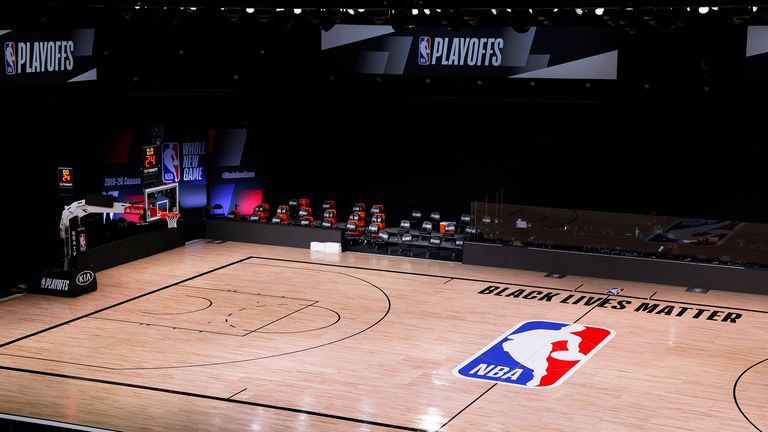 An empty court and bench is shown with no signage following the scheduled start time in Game Five of the Eastern Conference First Round between the Milwaukee Bucks and the Orlando Magic