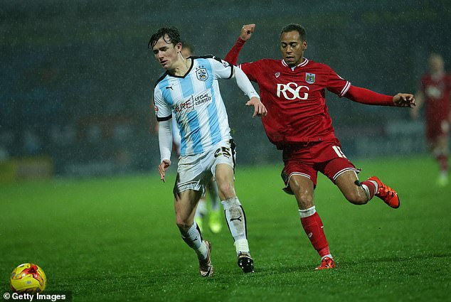 His loan spell at Huddersfield (left) gave him real experience of men's professional football
