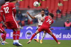 Arsenal's Pierre-Emerick Aubameyang curls in the opening goal.