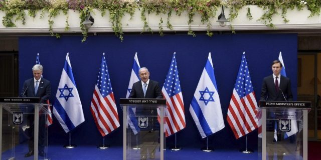 O'Brien, left, Netanyahu, center, and White House adviser Jared Kushner make joint statements to the press about the Israeli-United Arab Emirates peace accords, in Jerusalem, Sunday, Aug. 30, 2020. (Debbie Hill/Pool Photo via AP)