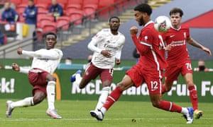 Arsenal's Eddie Nketiah, left, attempts a shot at goal.