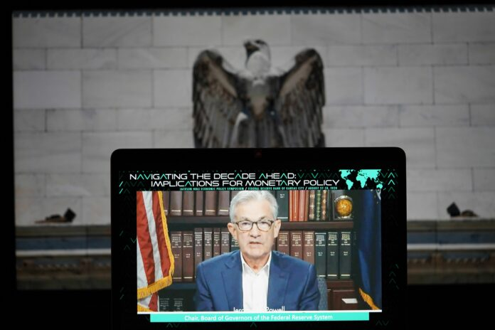WASHINGTON, Aug. 27, 2020 -- Photo taken on Aug. 27, 2020 in Arlington, Virginia, the United States, shows a screen showing U.S. Federal Reserve Chairman Jerome Powell delivering a speech to the Kansas City Fed's annual Jackson Hole research conference, which is held virtually this year because of the pandemic. Jerome Powell announced on Thursday that the central bank will seek to achieve inflation that averages 2 percent over time, a new policy strategy that will likely keep short-term interest rates near zero for years. (Photo by Liu Jie/Xinhua via Getty) (Xinhua/Liu Jie via Getty Images)