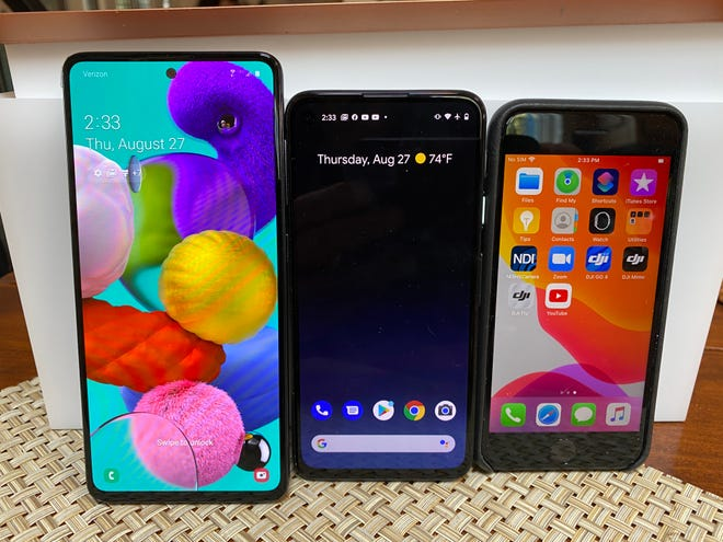 From left to right: Samsung's Galaxy A71, Google Pixel 4A and Apple iPhone SE