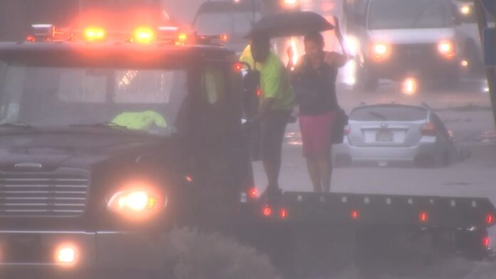 Isaias aftermath: Tow truck driver helps rescue woman from flooded Belmont Avenue