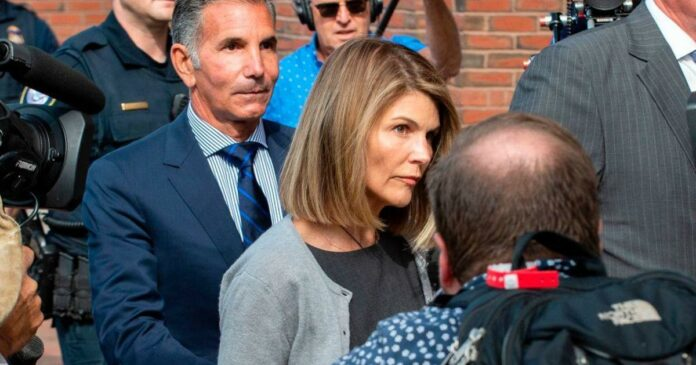 Lori Loughlin gets 2 months in prison in college admissions scandal. Her husband Mossimo Giannulli will serve 5 months.