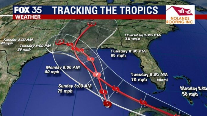 Marco downgraded to tropical storm; Laura strengthens slightly as storms eye Louisiana coast