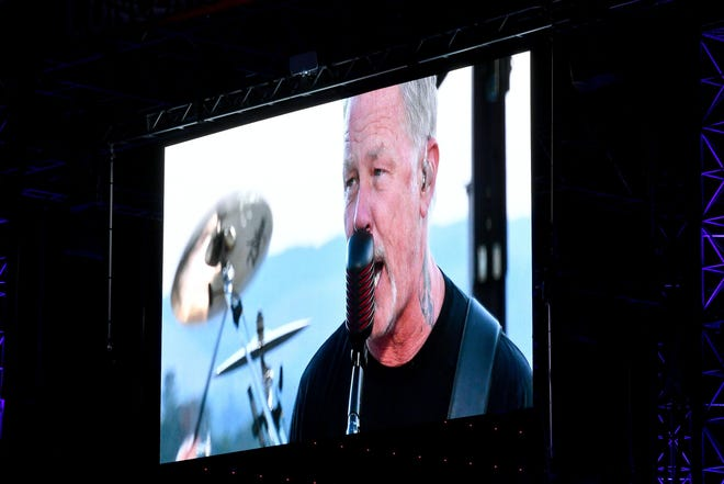 """James Hetfield of Metallica performing a pre-recorded concert during """"Encore Drive-In Nights Screen Metallica Concert"""" on Saturday."""