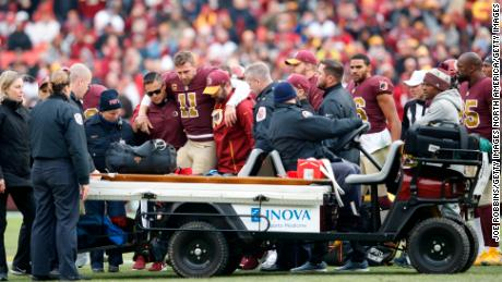 Alex Smith is helped off the field after his injury in November 2018.