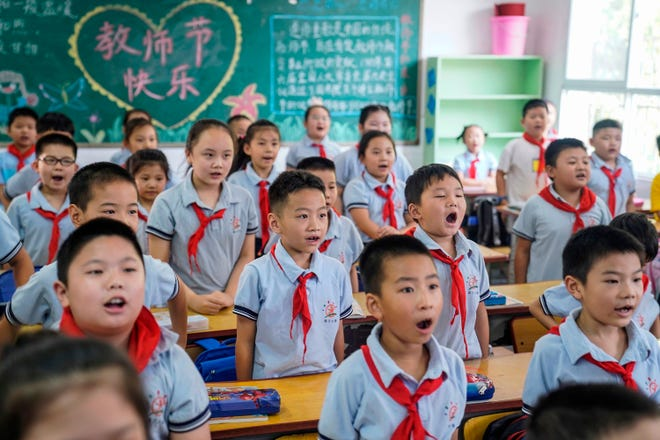Elementary school students participate in class on September 1, 2020 in Wuhan, Central Hubei Province, China, on the first day of the new semester.