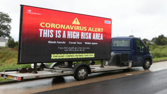 A mobile advertising vehicle displaying a coronavirus high risk area warning in Oldham, Greater Manchester, where residents have been told not to socialise with anyone outside their household and avoid using public transport unless it is essential. The localised measures have been introduced in Oldham, along with Blackburn and Pendle in Lancashire, following a rise in people testing positive for coronavirus.