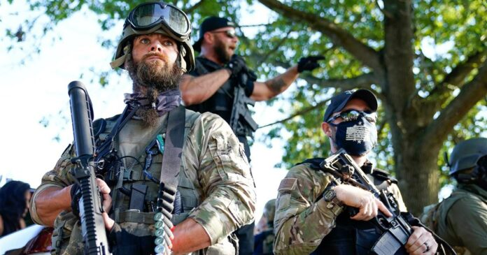 Armed military groups that oppose racial justice confront each other
