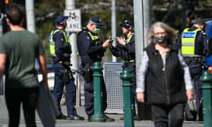 Police patrol an alley in Melbourne on September 6, 2020, as the state announced an increase in its strict lockdown law as it fights a fresh coronavirus outbreak.