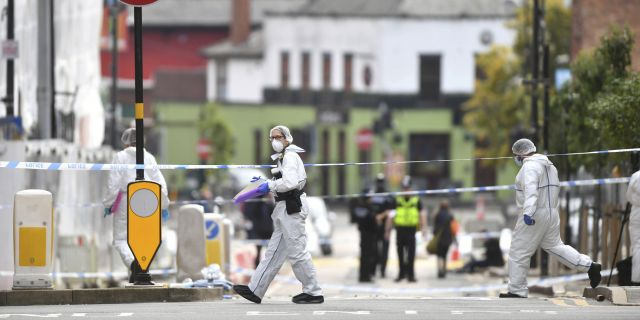 Police forensic officers investigate the scenes of a knife.  (AP / PA)