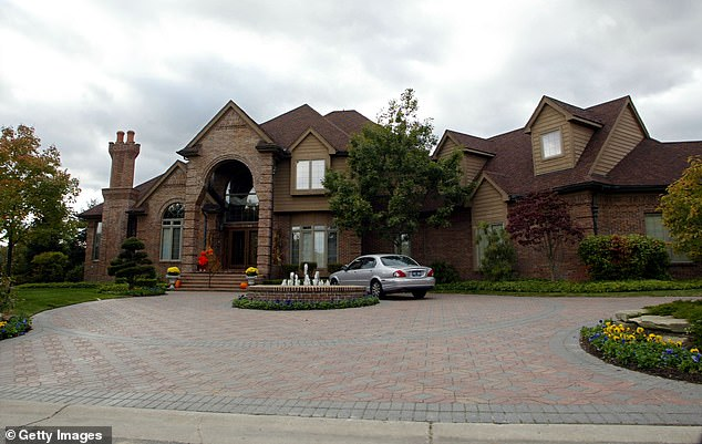 Exterior view of one of the rapper's previous homes in Detroit which he has since sold
