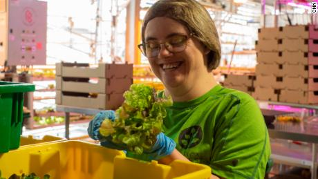 Mayka Miller, a vertical harvest employee, has packets of lettuce greens to deliver to one of the four grocery store groves in Jackson, Wyoming.