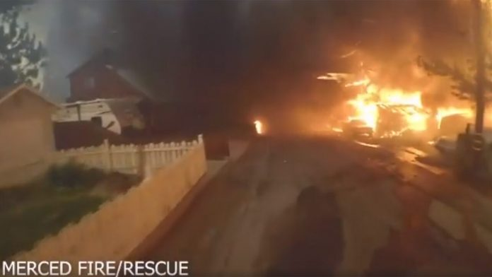 California firefighters face a 'wall of flames' in a dramatic video, with 250 Marines and sailors battling a creek fire