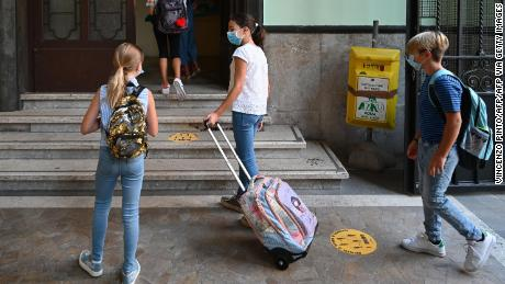 Masked students arrive for the start of the school year on September 14 at Luigi Einoudi Technical High School in Rome, Italy.