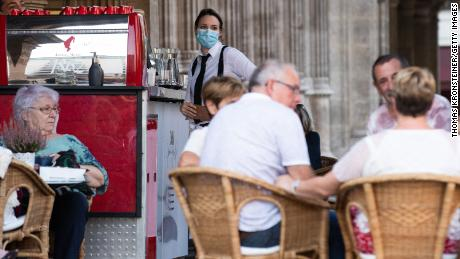 A waitress in Vienna wears a face mask in accordance with the new, stricter rules imposed by the Austrian government on September 14.