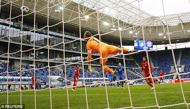 Oliver Baumann dives to his left but can do nothing to deny Joshua Kimmich in the 36th minute.