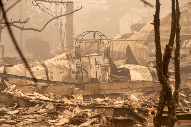 Remains of a house destroyed by a Beachy Creek fire east of Reg Sale's East Salem are among the smoke on September 13, 2020.
