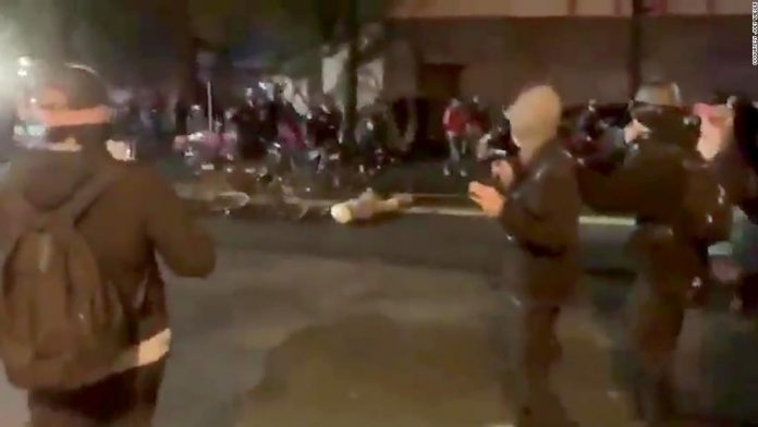 A Seattle police officer was captured on video riding a bicycle over the head of a protester on administrative leave.