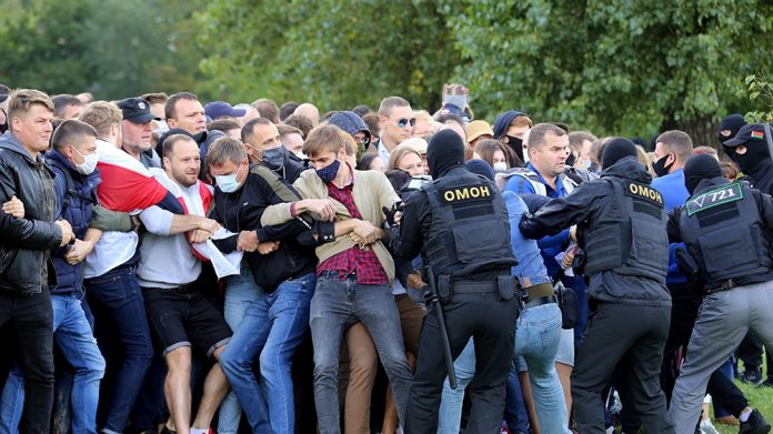 Belarus police in riot gear stormed a rally on Friday, removing hundreds of protesters by truck