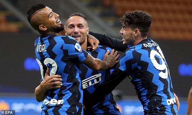 Danilo D'Ambrosio (C) celebrates after scoring the winning goal for Inter against Fiorentina