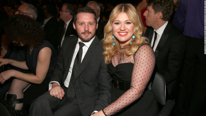 Kelly Clarkson says life was 'a little too much' after she filed for divorce.