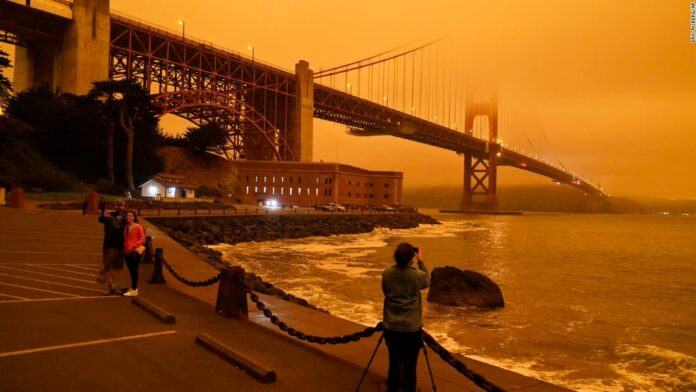 The skies of California turned orange during the wildfires in the photo show