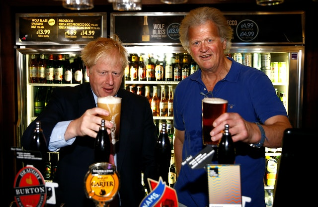 Boris Johnson and Tim Martin in Happy Times (Henry Nichols / PA)