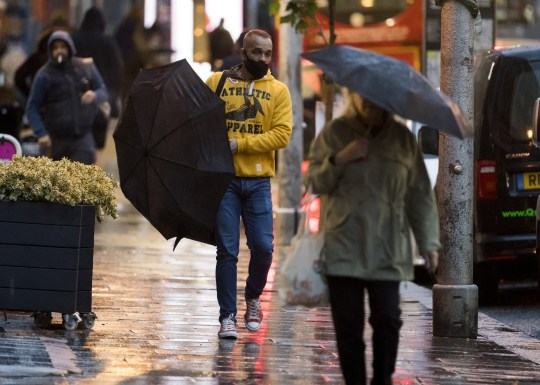 ?  Licensed for London News Pictures.  02/10/2020.  London, UK.  Members of the public battle through heavy rain and wind during a morning trip at Ladbroke Grove in West London, as Storm Alex brings 90 MPF wind and heavy rain over much of the UK.  Photo credit: Ben Couthra / LNP