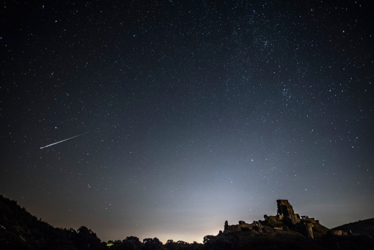 Corey Castle, United Kingdom - 12 August 12: A percussion meteor shone in the night sky above Corey Castle on 12 August 2016 at Corey Castle in the United Kingdom.  The Perseids meteor shower occurs every year as the Earth passes through a cloud of debris left by the comet Swift-Tuttle, and is seen revolving from the constellation Perseus in the eastern sky.  (Photo by Dan Keatwood / Getty Images)