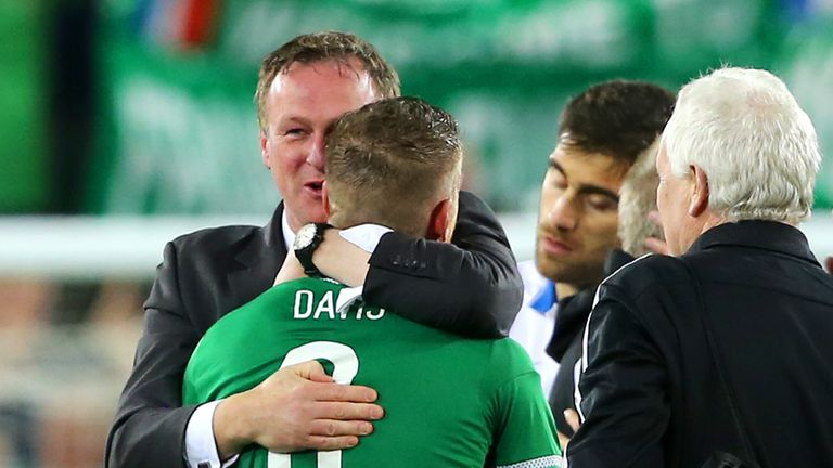 Northern Ireland boss Michael O'Neill congratulates Steven Davis after the final whistle of the UEFA European Championship qualifying match at Windsor Park.