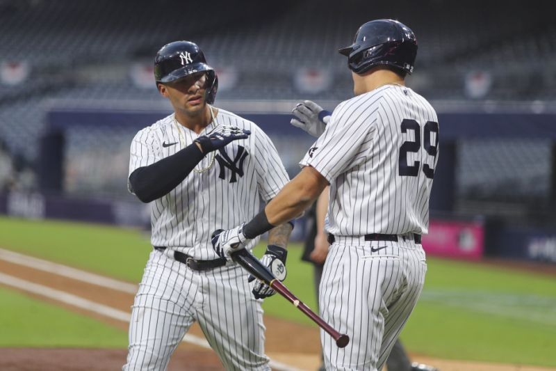 The New York Yankees 'Gleber Torres celebrated with Geo Ursella after running a two-run run in the sixth inning during Game 4 of the ALDS.  (Photo by Alex Trott Twig / MLB photos by Getty Images)