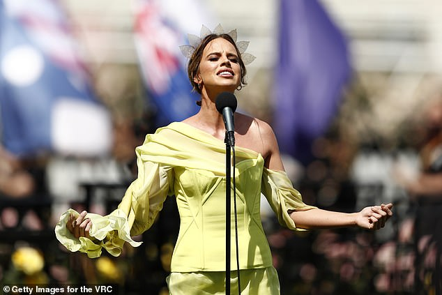 Singing to her heart's content: The Singer Singer winner and Neighbors Stars Bonnie Anderson also performed the Australian Australian National Anthem live from Flemington.