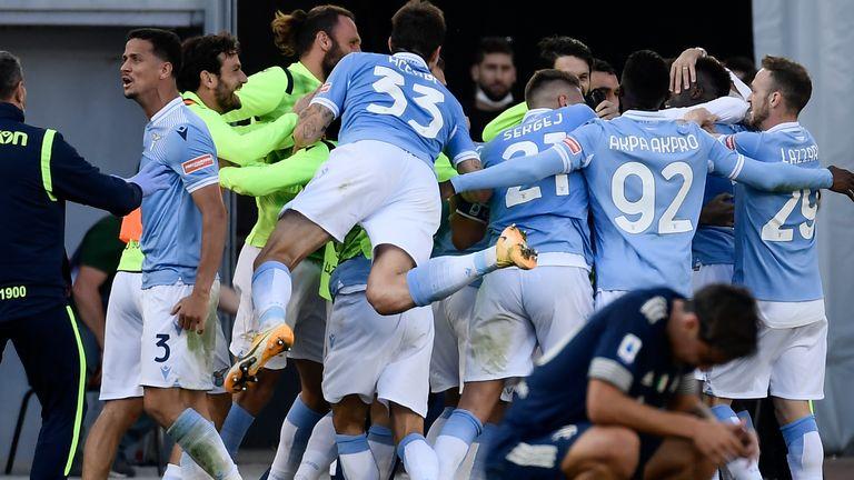 Lazio celebrates their late draw against Juventus