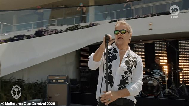 Pre-Race Entertainment: John Stevens made an emotional presentation of never tearing up a classic INXS song at the Melbourne Cup on Tuesday afternoon.