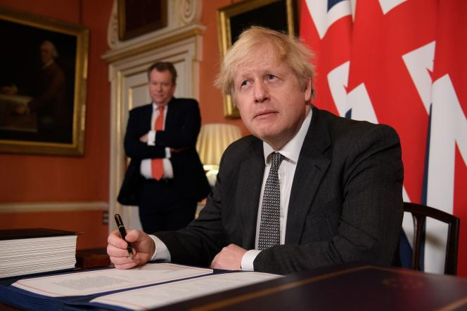 British Prime Minister Boris Johnson signs a post-Brexit agreement with the European Union on 10 December at 10 Downing Street, London.
