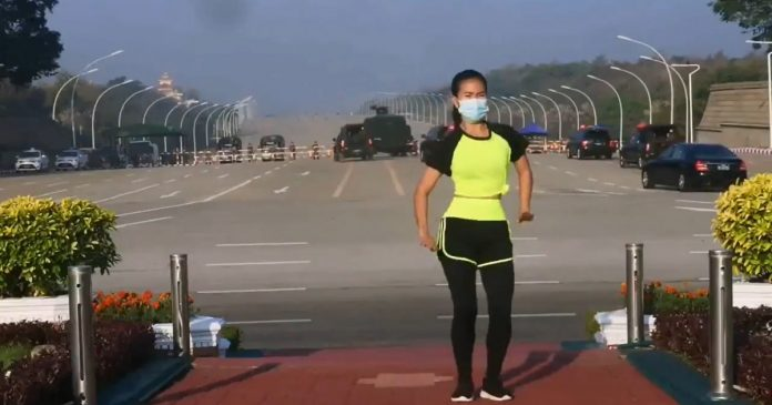 viral video.  Aerobics teacher does his number while behind the Myanmar coup