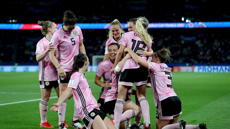 Scotland's Erin Cuthbert (indistinct) celebrates her team's third goal in a FIFA Women's World Cup Group D match at the Parc des Princes in Paris.