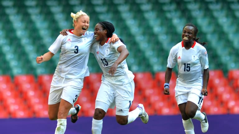 (L to R) Stephanie Houghton, Ifoma Dyke and Eniola Aluko of Great Britain celebrate the scoring during the Women's Pre-Round Group E match on 25 July 2012 in Cardiff, Great Britain, between Great Britain and New Zealand.  Great Britain won the match 1–0.